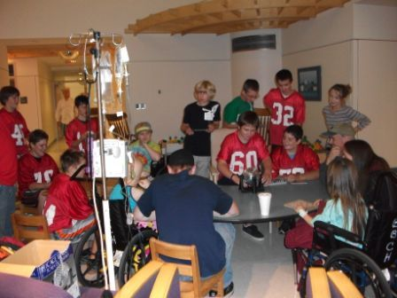 The Gray-New Gloucester Middle School football team recently visited the Barbara Bush Children's Hospital at Maine Medical Center and presented a check for $2,500 from money raised by the team during its annual pledge drive.