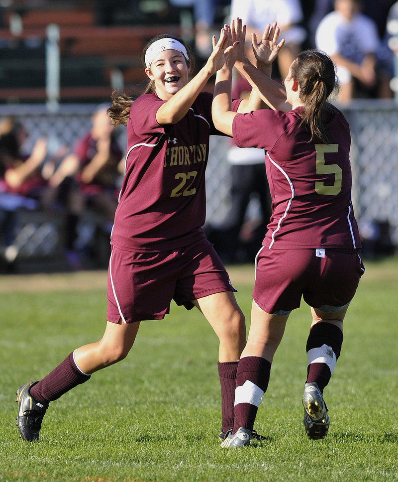 Lauren Titus, left, of Thornton Academy celebrates with Sarah Young after scoring a soccer goal Monday against Biddeford. Thornton won, 5-0.