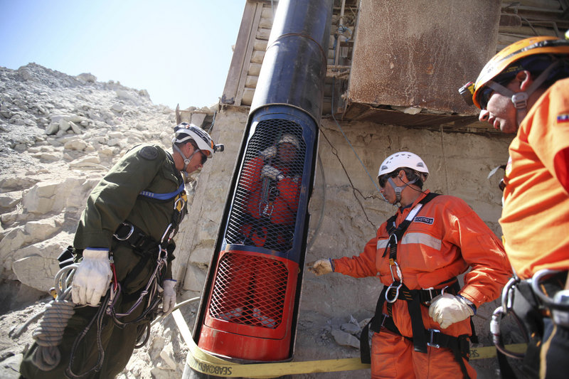 Rescue workers prepare to release a colleague from a capsule after performing a dry run Monday for the eventual rescue of the 33 miners trapped at the San Jose mine near Copiapo, Chile. The rescue apparatus worked flawlessly during four test runs.