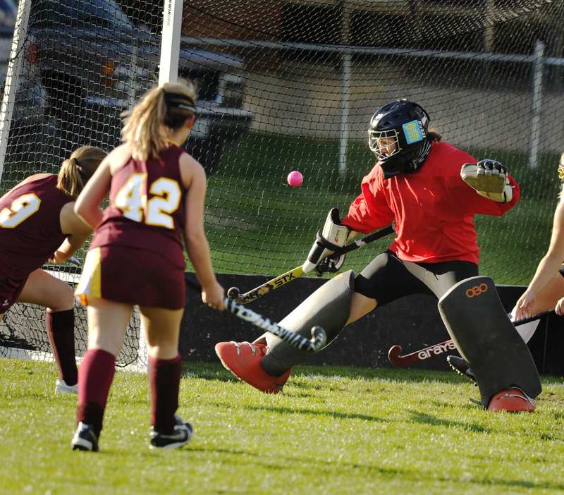 Morgan Ouellette-Foss, left, lifts a shot past Cheverus goalie Katie Semo after a pass from Breanna Thibodeau for a goal that helped Thornton to a 2-0 victory Tuesday.