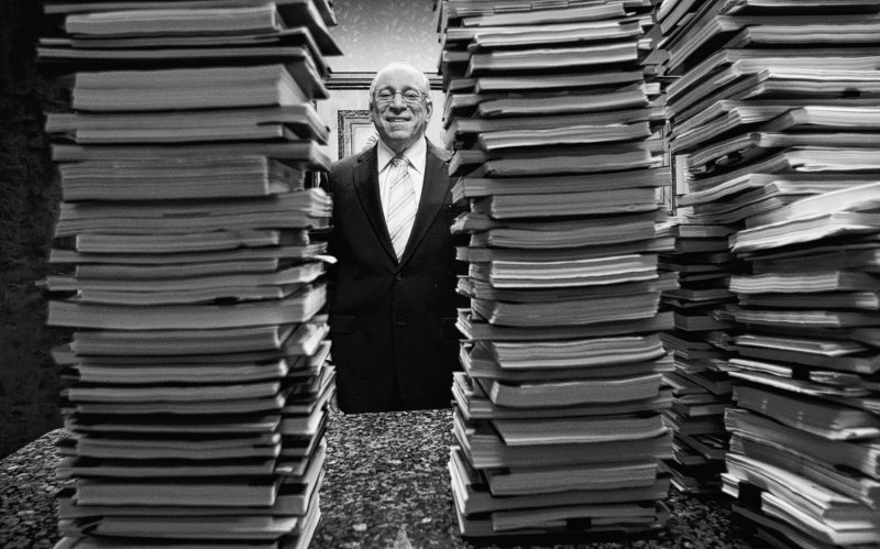 Florida lawyer Peter Ticktin, of The Ticktin Law Group, poses behind stacks of depositions from 150 robo-signers, people with no mortgage or document experience hired to sign foreclosure affidavits in many cases without reading them or knowing what they were signing.