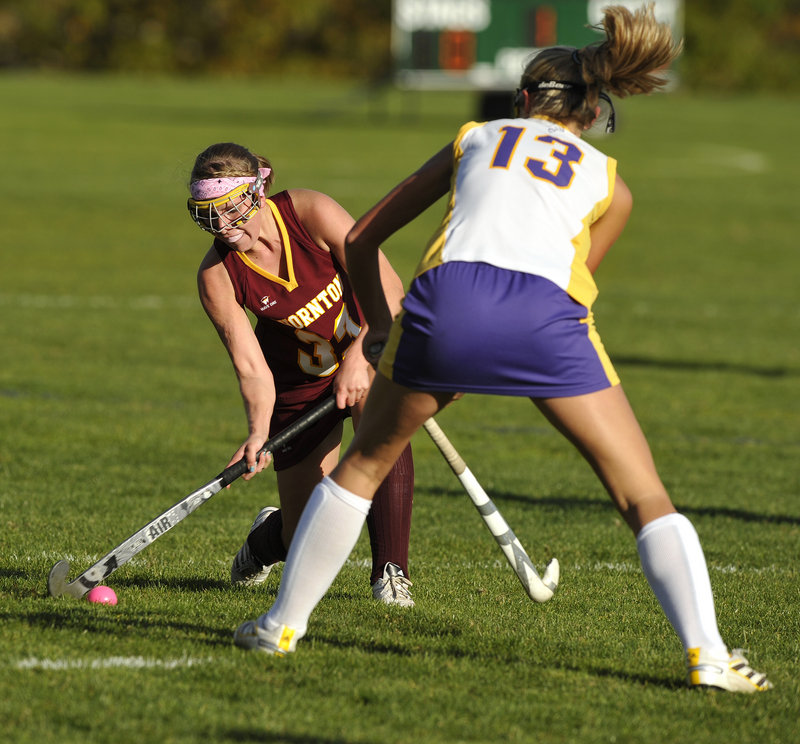 Karen Jacques of Thornton Academy tries to knock the ball past Brooke Flaherty of Cheverus. The Trojans scored a goal in each half.