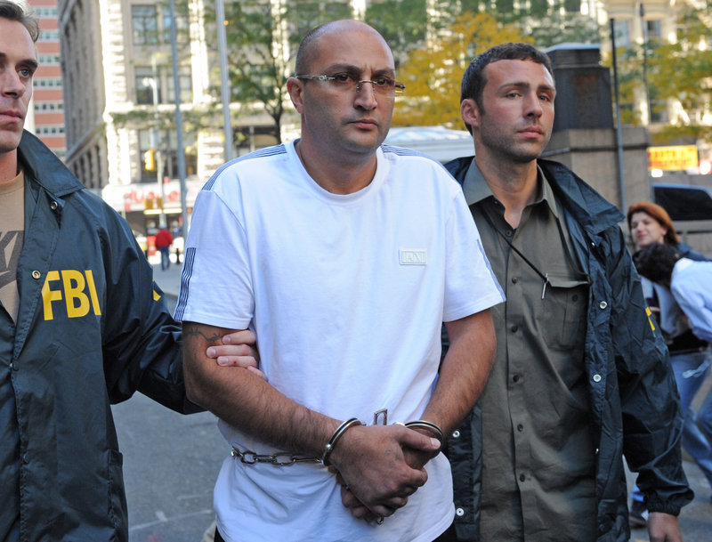 Robert Terdjanian is led from FBI headquarters Wednesday in New York. He's accused of Medicare fraud and hatching schemes involving untaxed cigarettes and counterfeit Viagra.