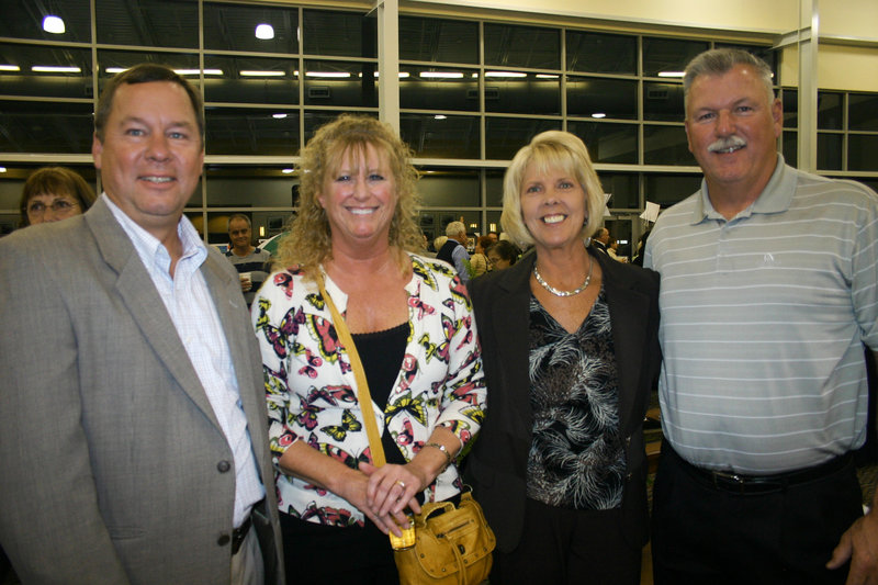 Jeff Ohman, who works for party sponsor Shaw's; Kathy Ohman; Noreen Savage, who also works for Shaw's and chaired the auction; and Mike Savage.