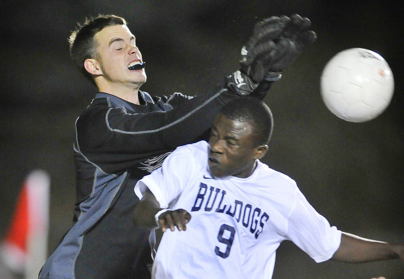 South Portland goalkeeper Shawn Shannon collides with Tony Yekah of Portland while knocking the ball away Thursday night during Portland's 4-1 victory at Fitzpatrick Stadium. Portland improved to 11-1-1; South Portland is 9-3-1.