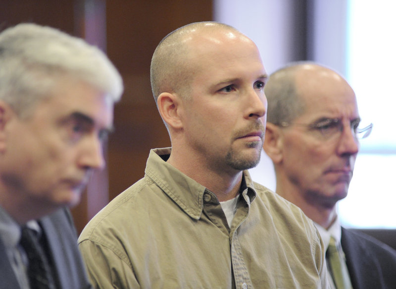Standing by attorneys Neale Duffett and Gerard Conley Jr., Nathan Allen, center, pleads not guilty to manslaughter and other charges Friday in Cumberland County Superior Court.