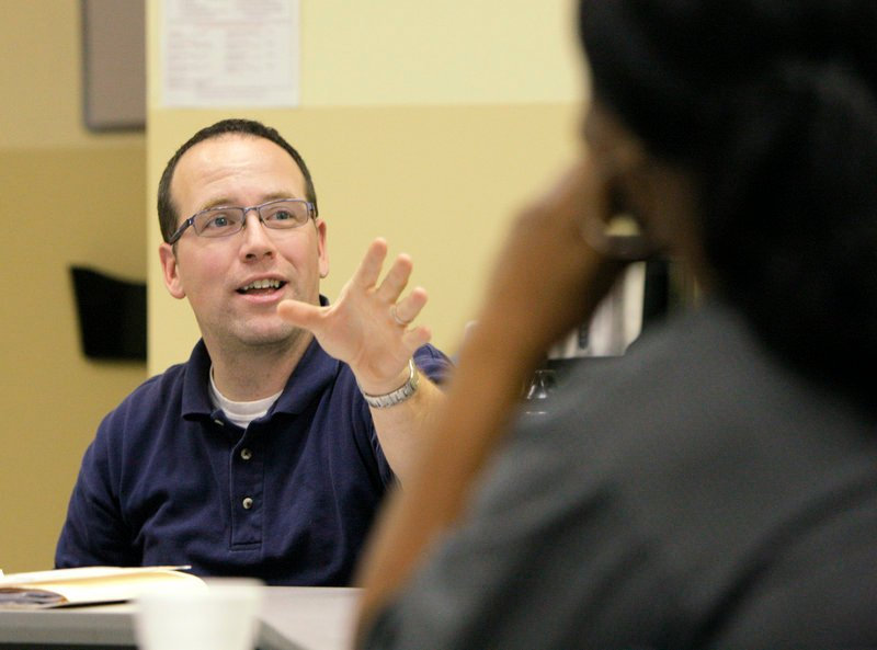 Aaron Geyer, the head of Portland's Workfare Program, holds an employment training session at the Portland welfare office last month.