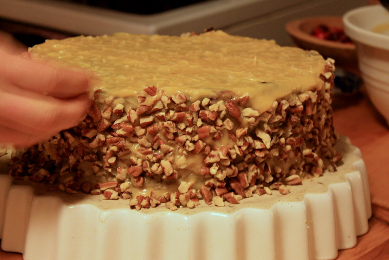Finishing touch: German chocolate cake gets a coating of toasted pecans.