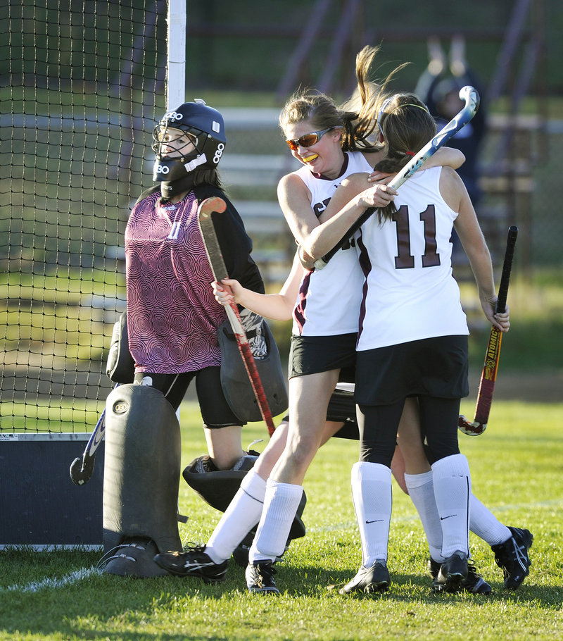 Eliza Porter of Greely hugs teammate Sarah Howard, 11, after scoring the goal that proved the difference Tuesday, giving the Rangers a 4-3 victory against Cape Elizabeth in a Western Class A quarterfinal.