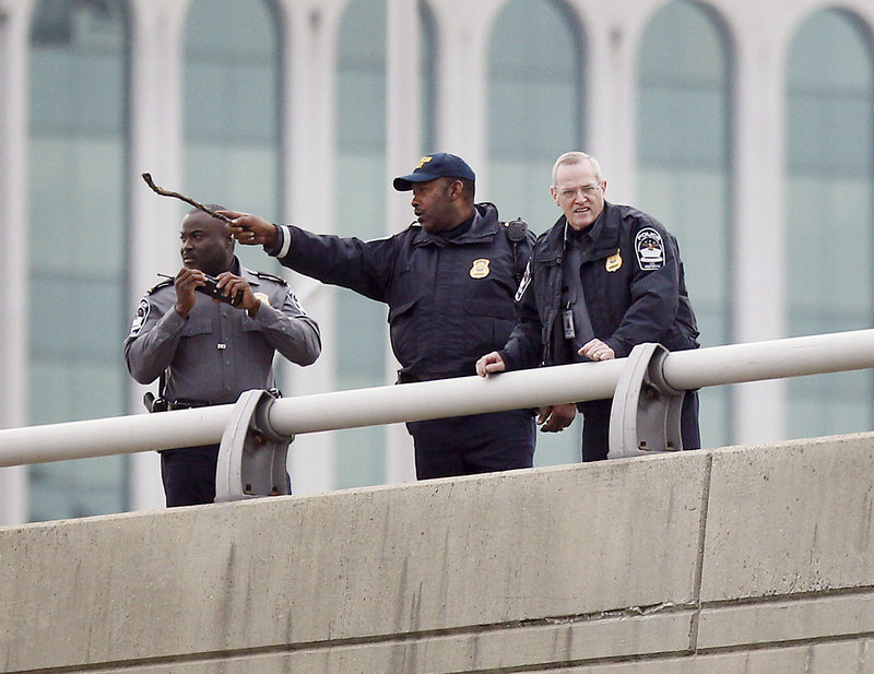 Police search for evidence along Interstate 395 near the Pentagon after Tuesday's shooting. The building and roads leading to it were briefly shut down for the investigation.