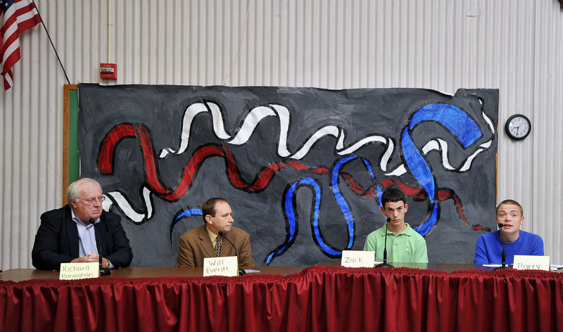 Discussions on allowing noncitizens to vote in municipal elections included, from left, Richard Ranaghan, Portland Charter Commission member, Will Everitt, director of the League of Young Voters, and students Zack Lane and Barry Quinn.