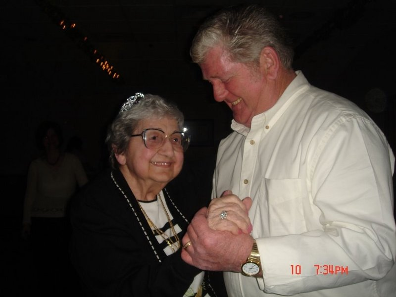 Sarah Brichetto dances at her 90th birthday party with her son Richard.