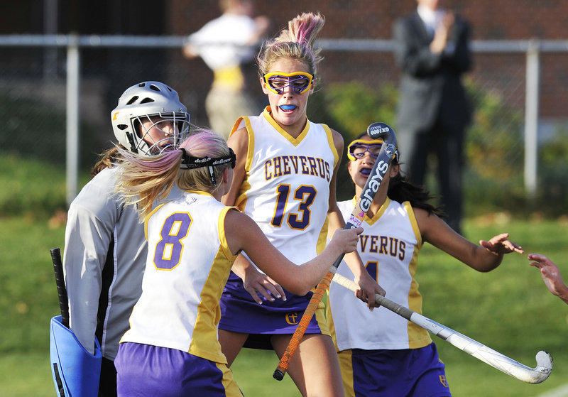 John Ewing/Staff Photographer Brooke Flaherty of Cheverus, 13, celebrates with Anna McDonough, 8, and Gabi Cardona after scoring late in the first half to tie it and swing the momentum against Kennebunk.