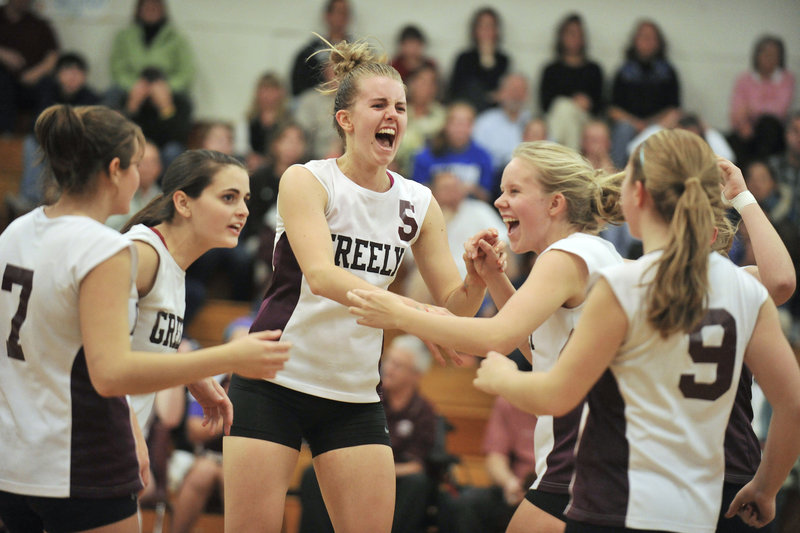 Sara Warnock leads the Greely celebration that includes Haleigh Roach, 7, and Danielle Cimino, 9, as the Rangers earned a spot in the Class A semifinals, beating Yarmouth.