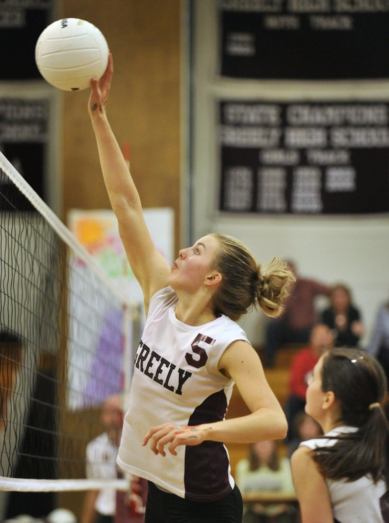 Elizabeth Bouchard of Greely hits a shot over the net Wednesday night during the four-game victory against Yarmouth. Greely will meet top-ranked Biddeford in the semifinals.