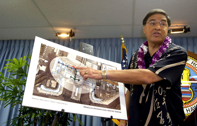 Honolulu Mayor Mufi Hannemann discusses a newly proposed rail station at the Honolulu International Airport during a news conference earlier this year. Republican Gov. Linda Lingle announced recently that she wouldn't sign off on the federally subsidized project until an updated economic study is conducted.