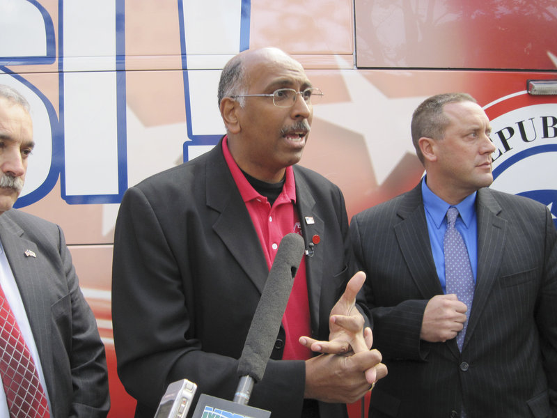 RNC chairman Michael Steele speaks to the media in front of the bus, which is part of a campaign to visit 48 states and 100 cities before Election Day.