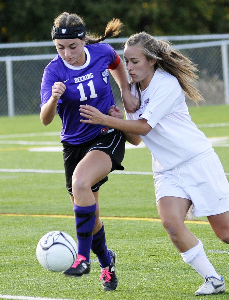 Amanda Masse of Deering controls the ball and looks for a way past Abigail Houghton of Cape Elizabeth. The Capers play Scarborough next.