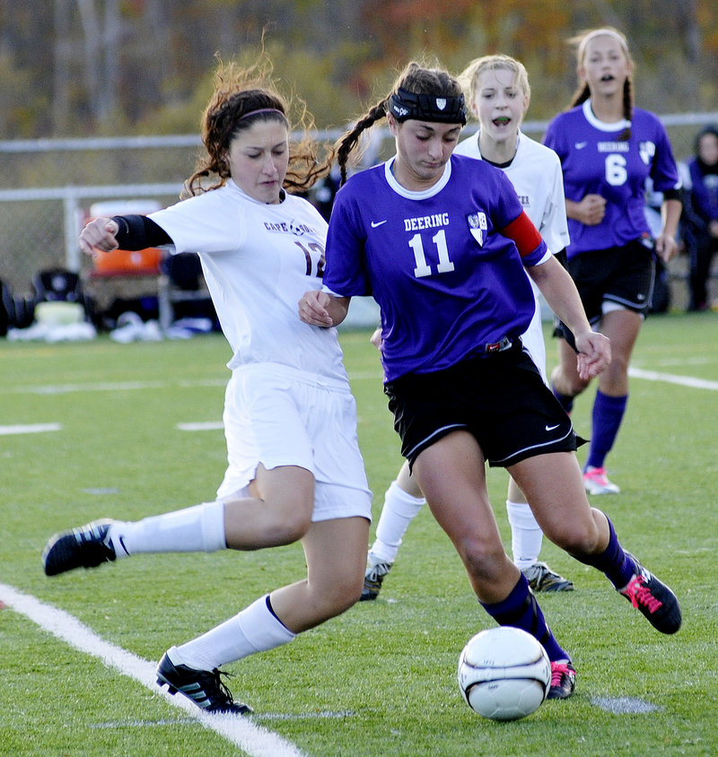 Amanda Masse of Deering attempts to advance the ball Friday as Hannah Dineen of Cape Elizabeth attempts to knock it away during the first half of Cape Elizabeth s 1-0 victory in a Western Class A girls' soccer prelim game.