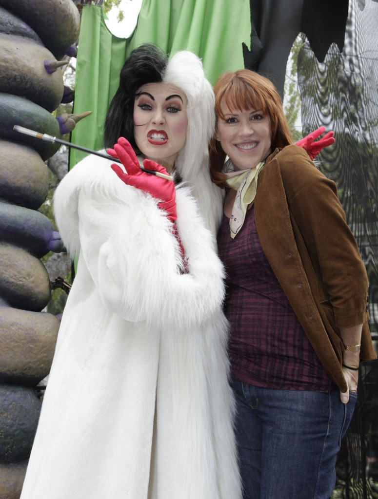 """Actress Molly Ringwald poses with the Disney character Cruella de Vil at Disneyland in Anaheim, Calif., on Friday, during a visit to the resort's """"Halloween Time"""" celebration, running through Oct. 31."""
