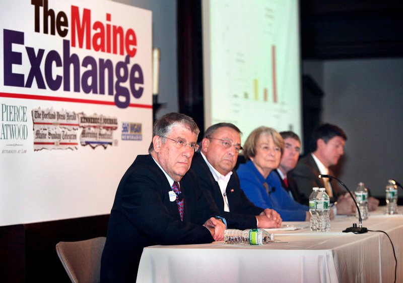 Maine's gubernatorial candidates, from left, Eliot Cutler, Paul LePage, Libby Mitchell, Shawn Moody and Kevin Scott listen as a question is posed during The Maine Exchange at the First Parish Unitarian Church in Portland on Saturday.