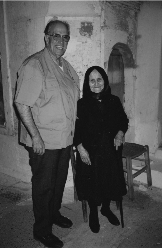 John Anagnostis poses with a Greek woman on one of his many trips to Greece.