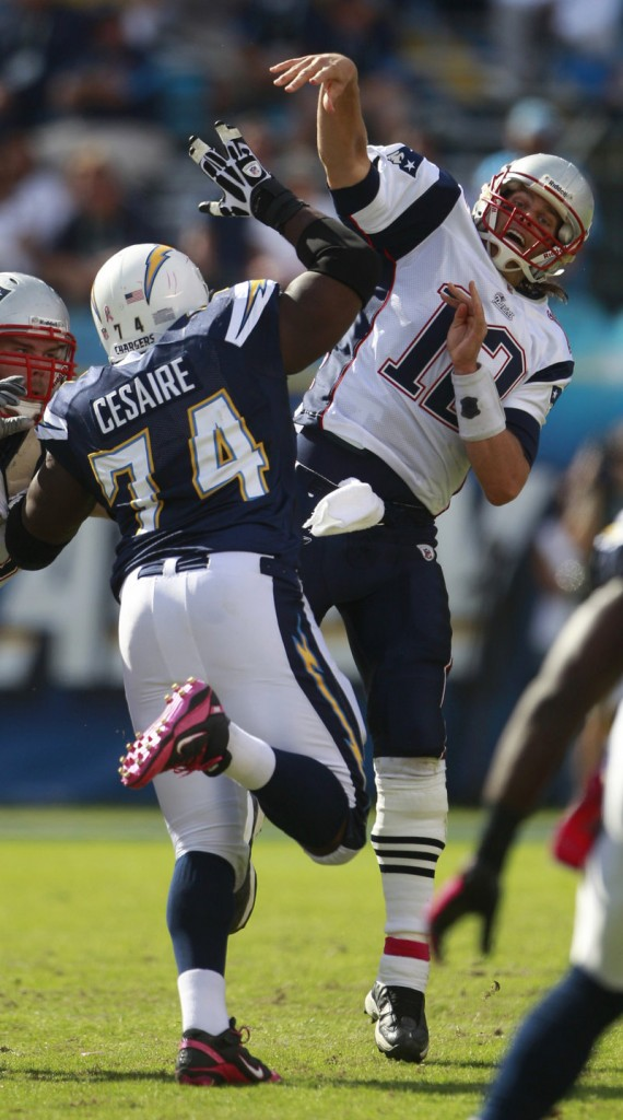 Jacques Cesaire puts pressure on Tom Brady in the second half Sunday. Brady hit 19 of 32 passes for 159 yards and a touchdown.