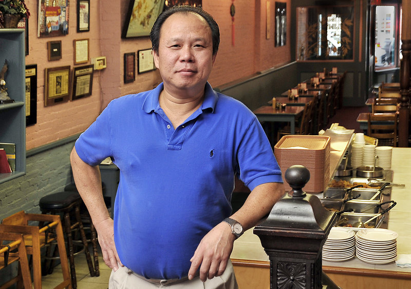 "Yan Lam offers a popular luncheon buffet at the Oriental Table, 106 Exchange St. in Portland. ""I don't mind the hard work at all,"" he said."