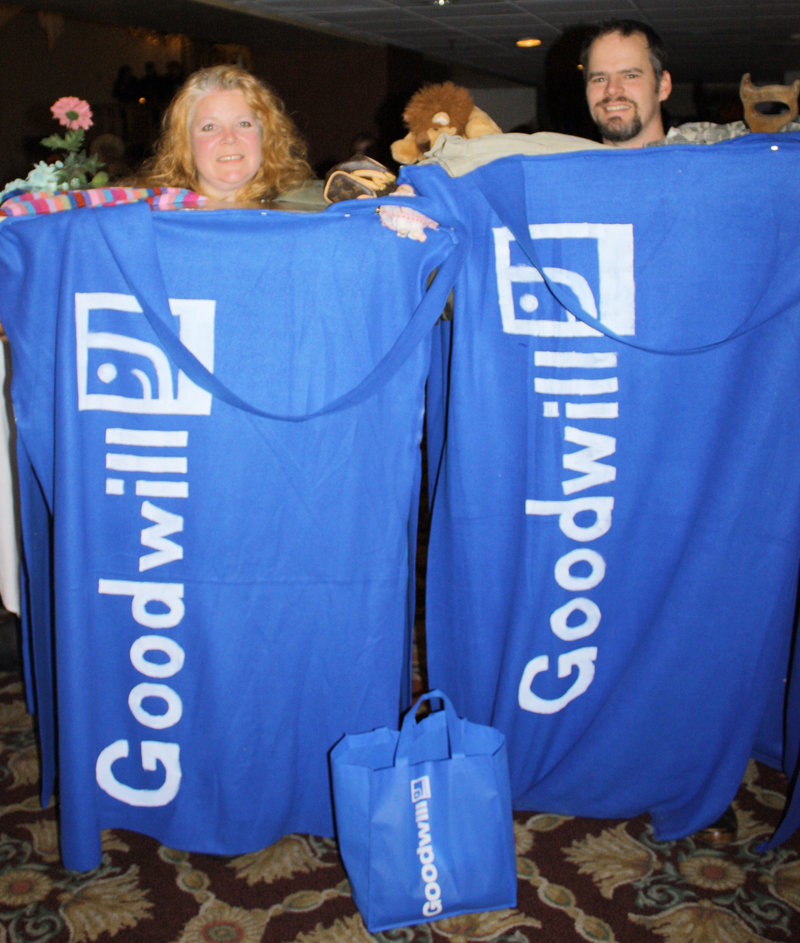 Jennifer Libby-Barnes and Robert Barnes, who won the Best Group Costume award dressed as Goodwill shopping totes.