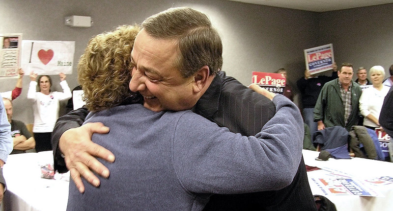 Republican gubernatorial candidate Paul LePage embraces a supporter Wednesday morning in a room at the Augusta Civic Center, where he received endorsements from some business leaders and the National Federation of Independent Business.