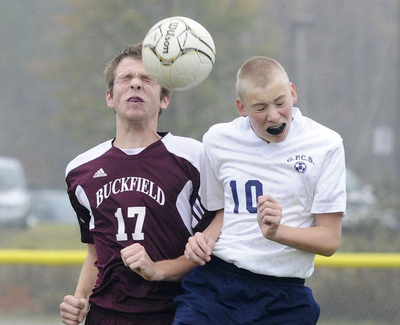 Derrick Belanger of Buckfield, left, and Eric Pearson of Greater Portland Christian go up for a ball Wednesday during their Western Class D quarterfinal in South Portland. Greater Portland Christian won 2-1 in the second overtime and will meet top-ranked Greenville in the semifinals.