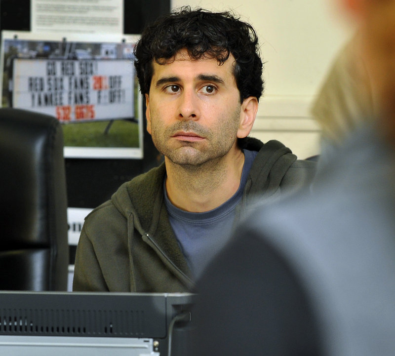 """John Cariani listens to a reading of his new play, """"Last Gas,"""" at Portland Stage Company. The playwright has rewritten parts of the play throughout three weeks of rehearsals, and last week, the actors tried several endings to see what worked best."""