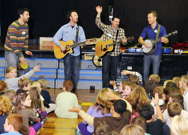 In this file photo, the band Guster performs at Longfellow Elementary School. The band is, from left, Brian Rosenworcel, Ryan Miller, Adam Gardner, who is from Portland, and Luke Reynolds.