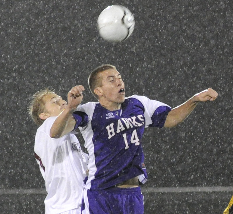 Tyler Hickey of Marshwood positions himself in front of Blake Barritt of Cape Elizabeth to unleash a header during the Capers' 5-0 victory in a Western Class A quarterfinal.