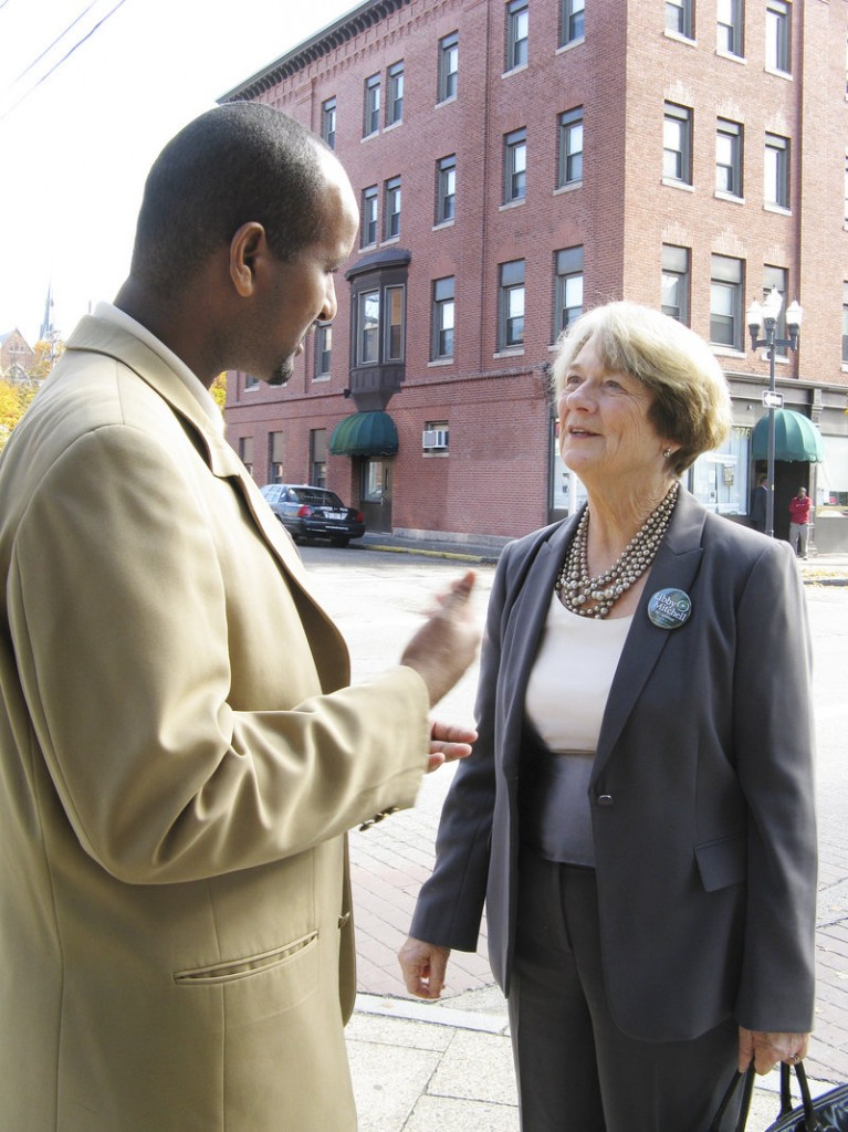 LIbby Mitchell talks with Hussein Ahmed, head of the African Immigrants Association in Lewiston, as her walking tour Thursday visited several Somali-operated shops.