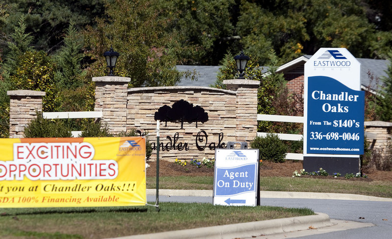 Home sales, like this heavily advertised Chandler Oaks development in McLeansville, N.C., will continue to struggle in the near term until job growth gains real traction, said Larry Yun, chief economist at the National Association of Realtors.