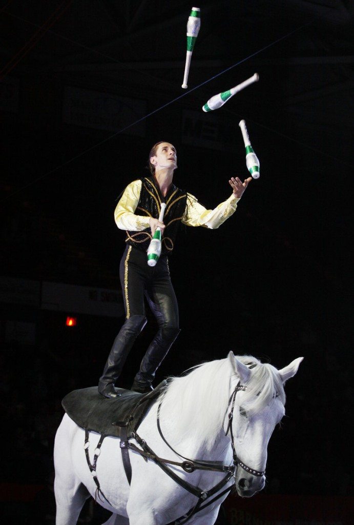 A performer juggles while perched atop a horse during a circus performance at the Cumberland County Civic Center on Thursday.