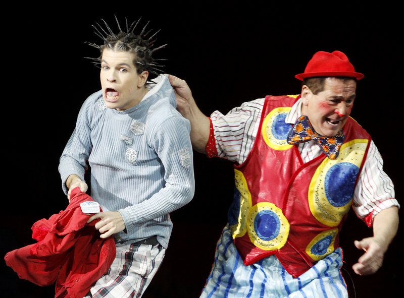 Stevie Caveagna and his father Artiduro Caveagna perform a hair-raising sketch as part of the crowd-pleasing circus at the civic center.