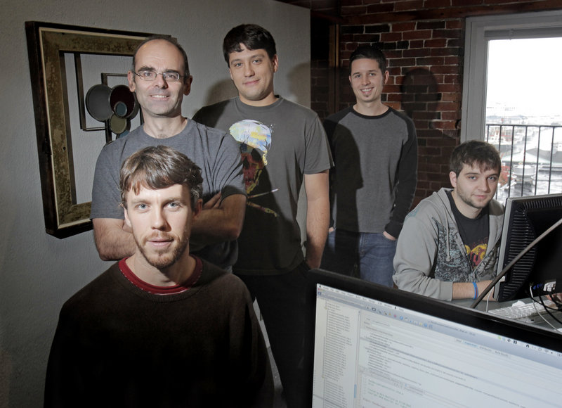 The staff of Tap Tapas in Portland develops applications for the iPhone and iPad. From left are Billy Flaherty, Mark Woolard, Michael DeSouza, Justin Velgos and Jordan Sage.