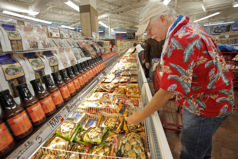 Michael Jubinsky of Lyman looks over a frozen food selection at Trader Joe's. Jubinsky and his wife, Sandy, run the Stone Turtle Baking and Cooking School in Lyman.