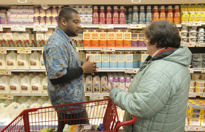Marsha Marley of Portland talks with Trader Joe's crew member Terry Hand during the Portland store's grand opening Friday.