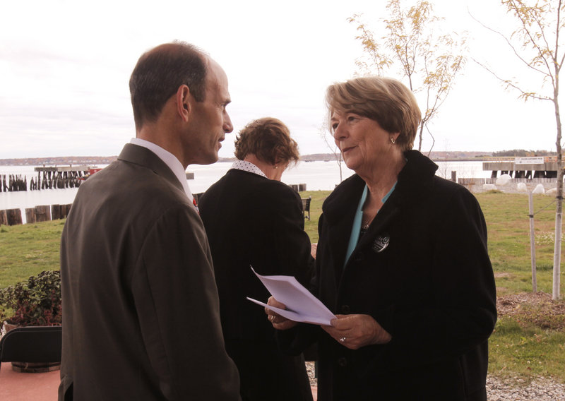 Candidate Libby Mitchell talks with Gov. John Baldacci at a groundbreaking ceremony at the Ocean Gateway terminal in Portland on Friday. Baldacci noted that Mitchell helped negotiate the bond issue that funded the pier project.
