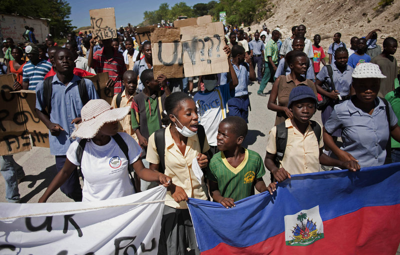 Protesters who blame U.N. peacekeepers from Nepal for Haiti's widening cholera epidemic march on a rural military base in Mirebalais, Haiti, on Friday to demand the soldiers leave the country. More than 4,700 people have been hospitalized and at least 330 have died.