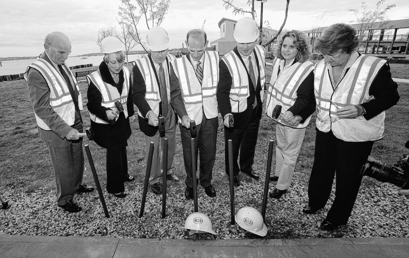 The groundbreaking ceremony for the deep-water megaberth, called Pier II at Ocean Gateway, was held Friday on Portland's waterfront. Officials in the photo, from left, are Portland City Manager Joe Gray, State Sen. Libby Mitchell, Portland Mayor Nicholas Mavodones, Gov. John Baldacci, Jackson Parker, President and CEO of Reed & Reed, Jennifer Duddy, representing Sen. Susan Collins and Portland City Councilor Cheryl Leeman, representing Sen. Olympia Snowe.