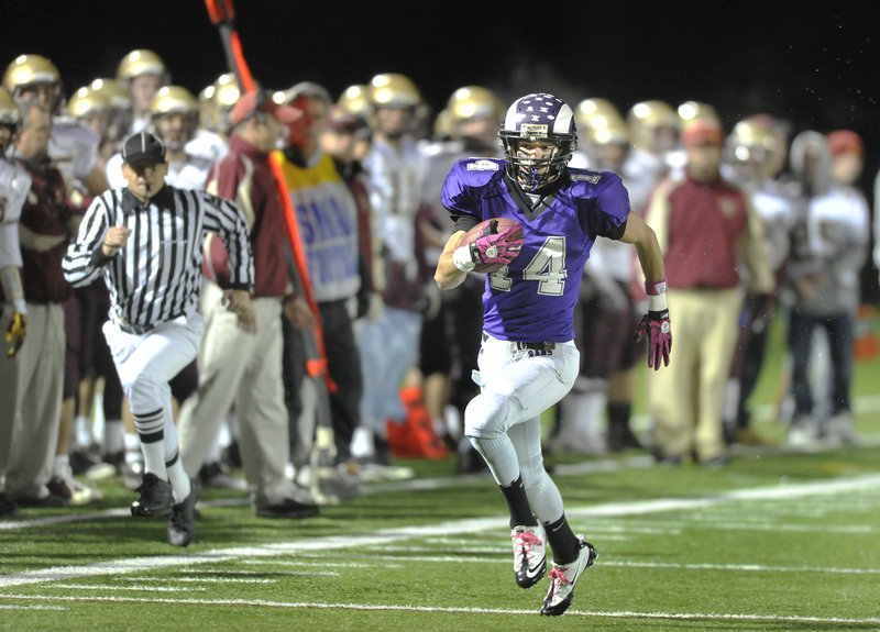 John Hardy of Deering breaks away for a touchdown on a 65-yard punt return Friday night the first score for the Rams in a 56-18 victory against Thornton Academy. Hardy also scored on a 46-yard pass as the Rams advanced to meet Bonny Eagle in the Western Class A semis.