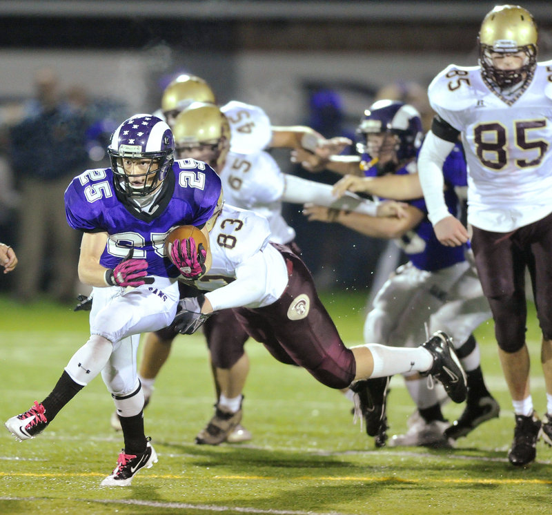 Trey Thomes of Deering finds room Friday night and breaks into the Thornton Academy secondary. Deering used a late spurt in the first half, then a 21-point third quarter for a 56-18 victory in a Western Class A quarterfinal.