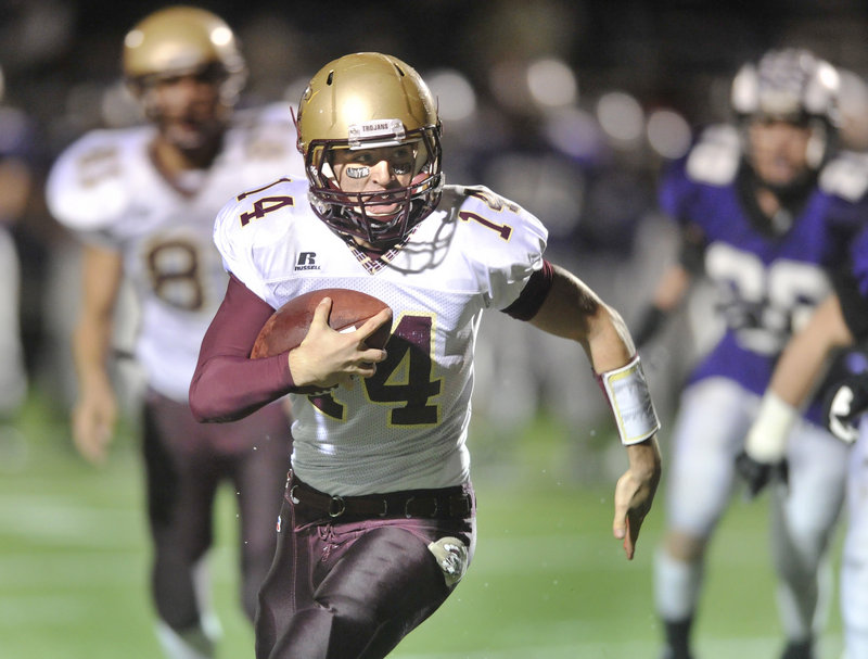 Thornton Academy quarterback Josh Woodward finds room down the field. Woodward scored on a 14-yard run in the second quarter at Deering High.