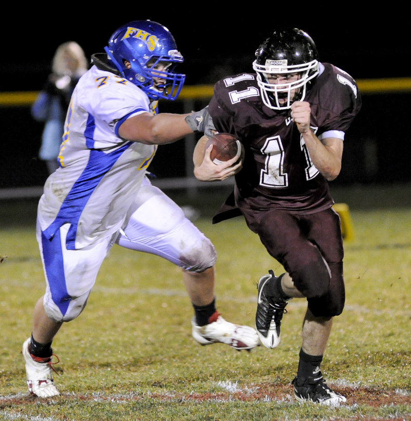 Andrew Edwards of Falmouth gives chase against Mike Leeman of Greely during their Western Class B game at Cumberland. Next stop: a coin flip.