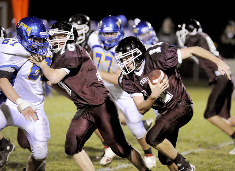 Mike Leeman of Greely follows a block by Tim Storey against Matt Darcy of Falmouth as the Rangers pick up yards Friday night. Falmouth won 15-14 on a 2-point conversion following a touchdown in the final minutes.