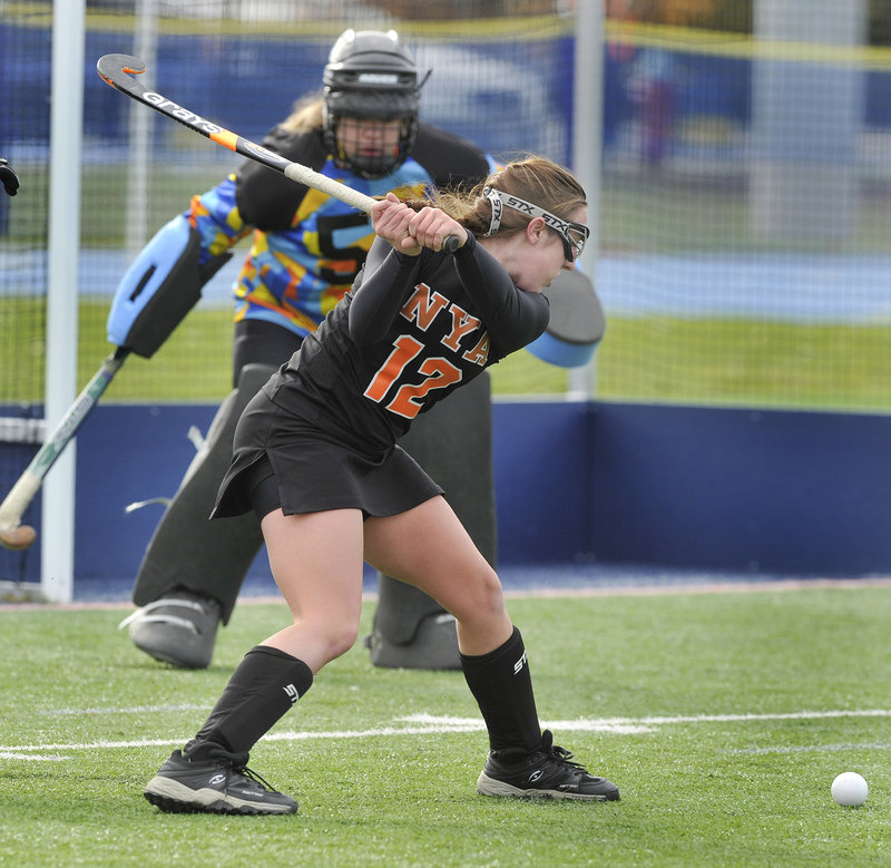 Megan Fortier of North Yarmouth Academy lines up a shot Saturday against Foxcroft Academy goalie Cassie Curtis. NYA won the Class C field hockey title on penalty corners.